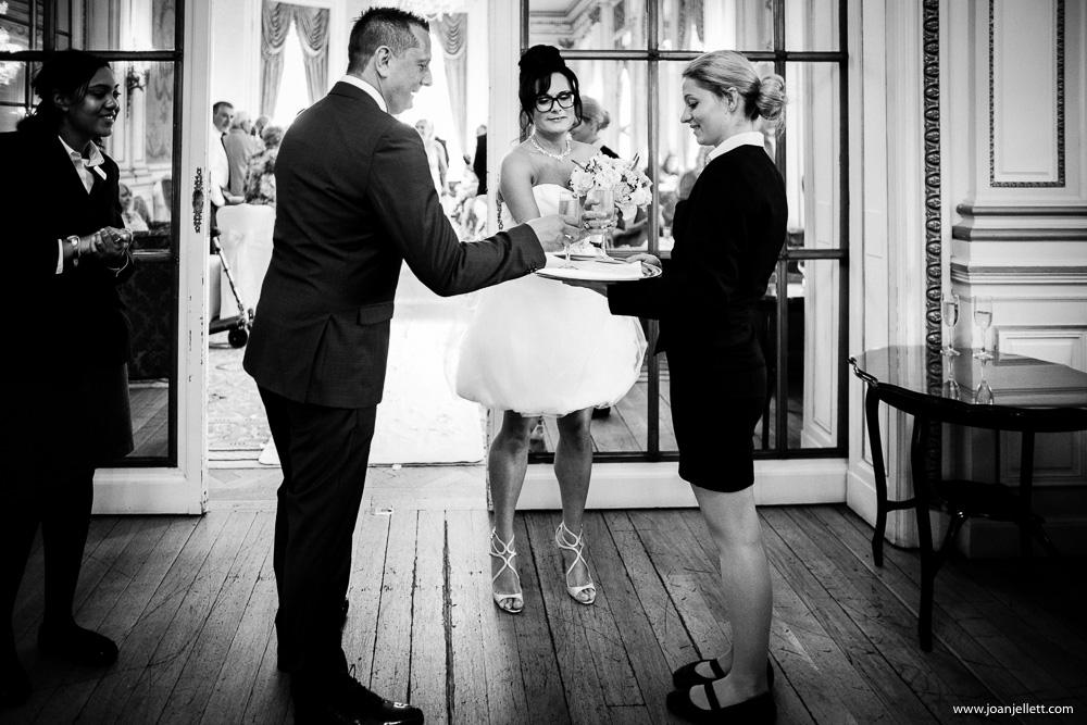 blacka nd white shot of bride drinking