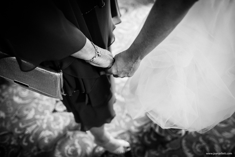 black and white shot of bride holding hand