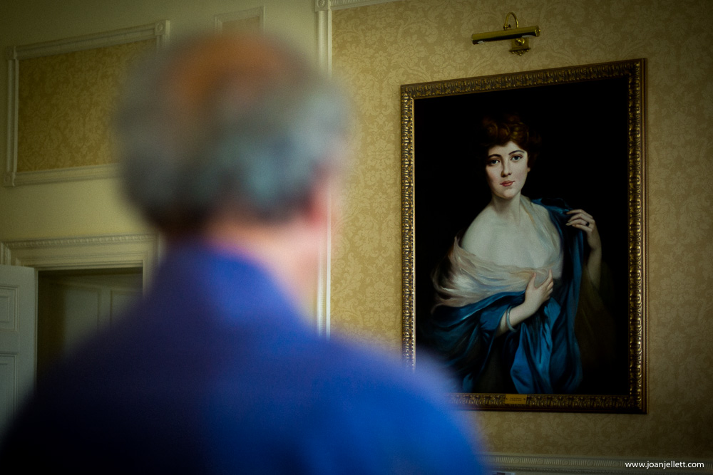 father of the bride looking at a painting