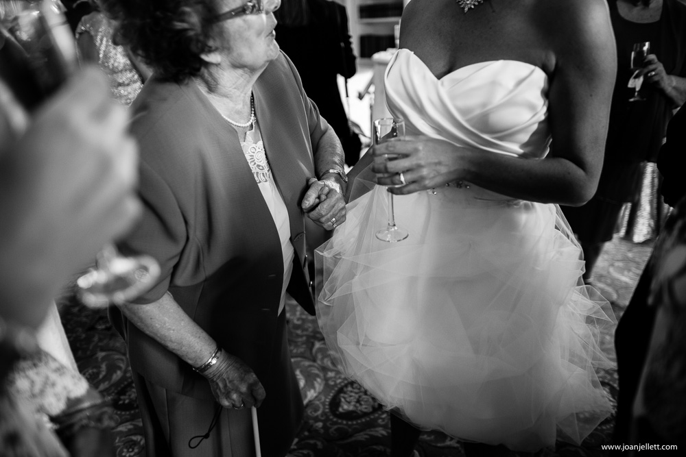 bride holding hand with a guest