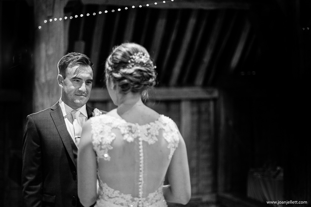groom looking lovingly at his bride during the ceremony