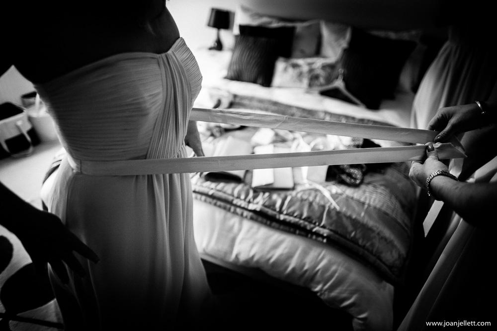 dress being fastened in Knebworth