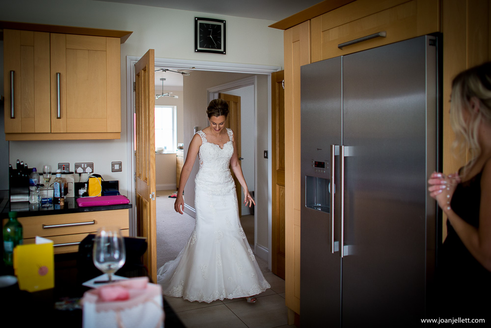 bride arriving in the kitchen