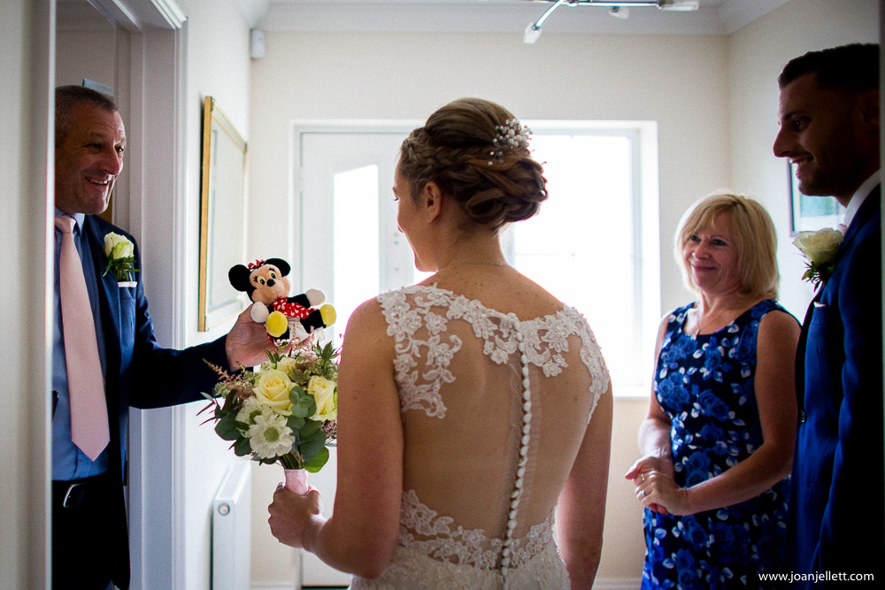 father of the bride giving her a cuddly toy