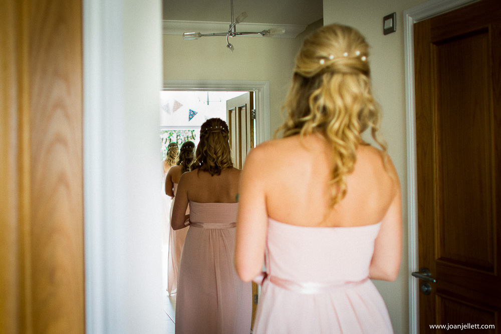 bridesmaids walking down the house