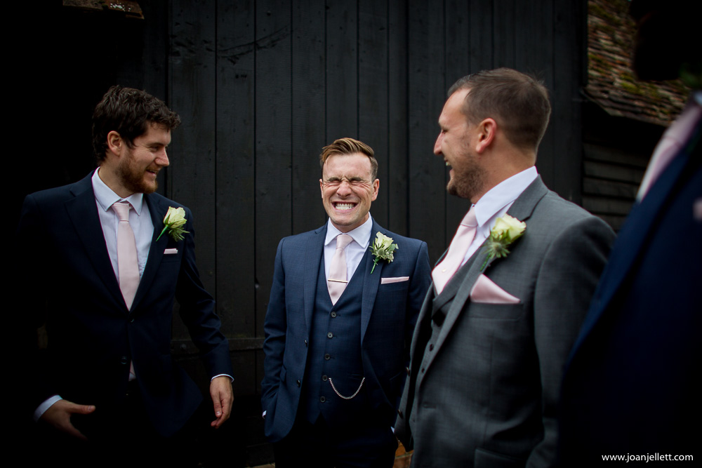 groom laughing in the priory little Wymondley