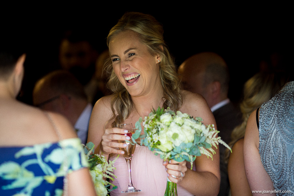 bridesmaid laughing in the barn