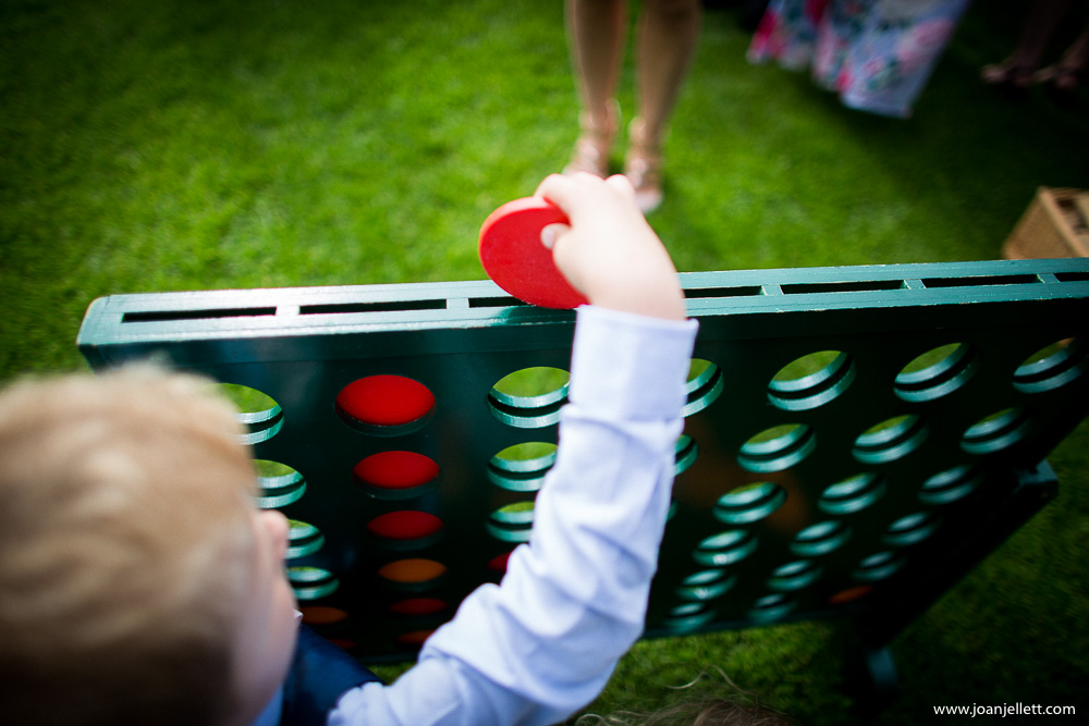 connect 4 boy playing outside