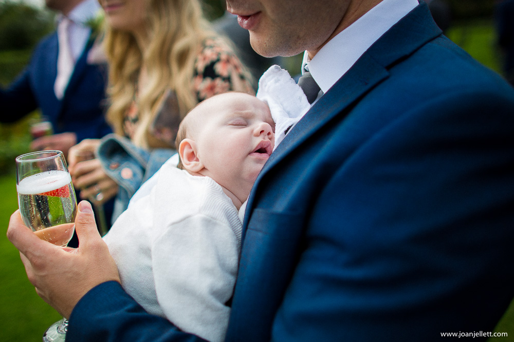 baby asleep in daddy's arms