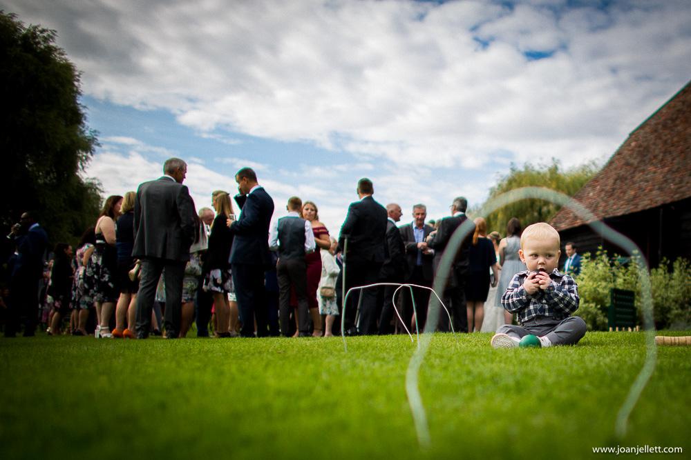 little boy sat on the grass