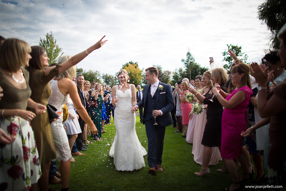 confetti shot of bride and groom