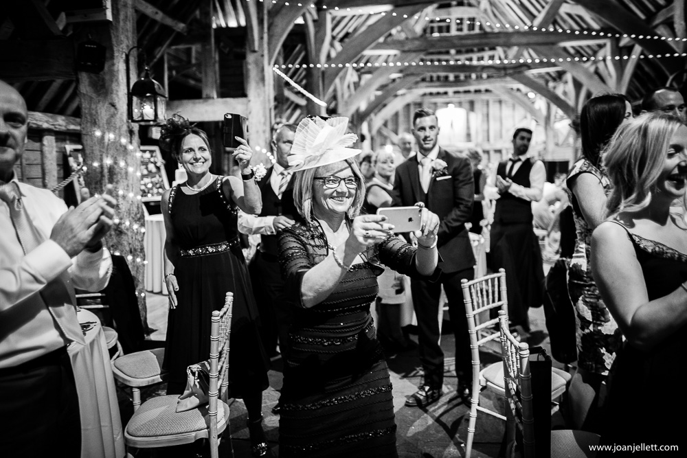 black and white shot of guests taking pictures