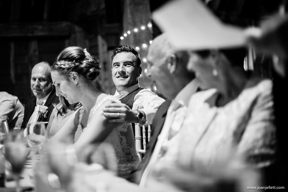 black and white shot of groom looking at bride