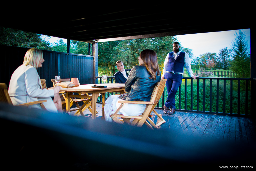 guests chatting outside the barn