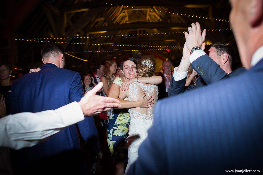 bride getting a hug from a guest