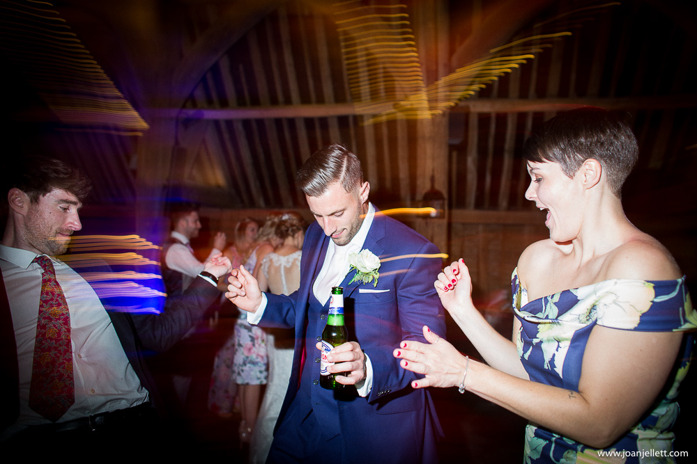 best man dancing with guests