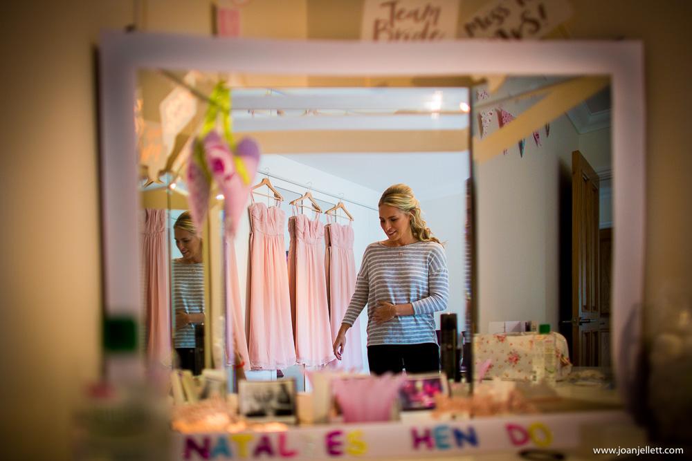 bridesmaid in bride's bedroom smiling