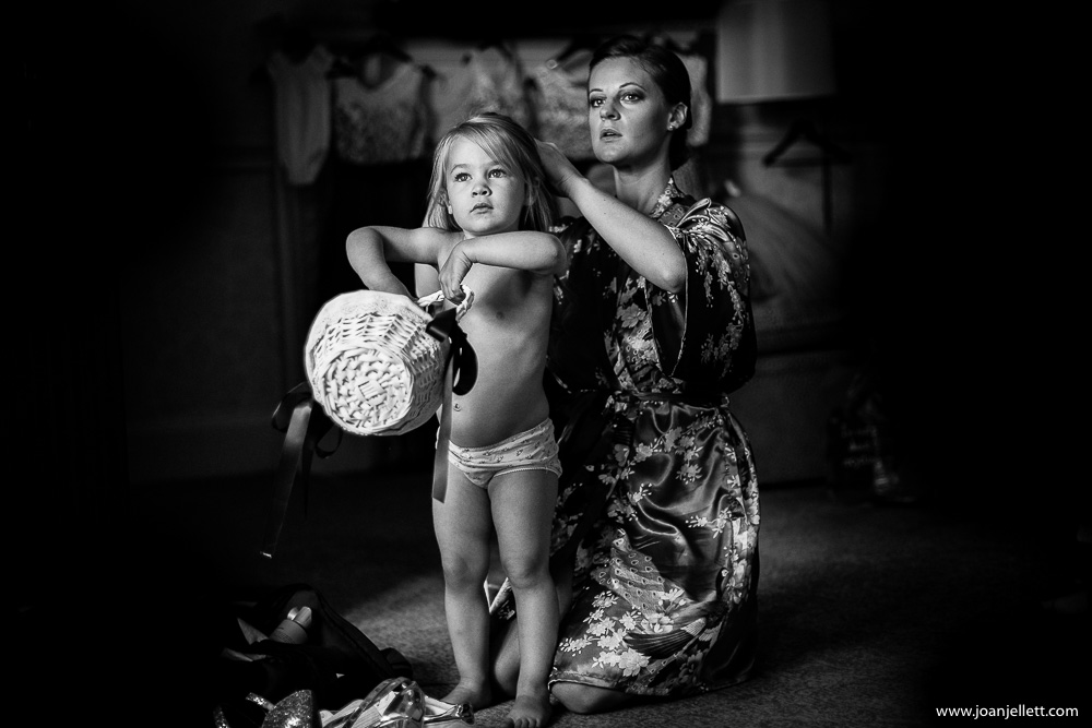 black and white shot of flower girl and her mother