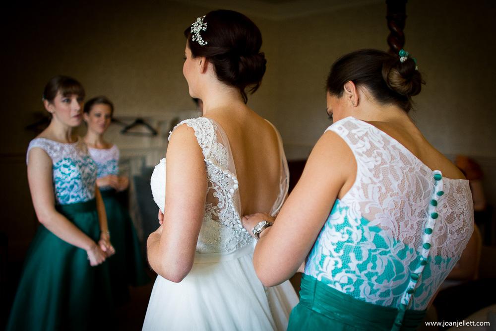 bridesmaid laughing with the bride at Hanbury manor