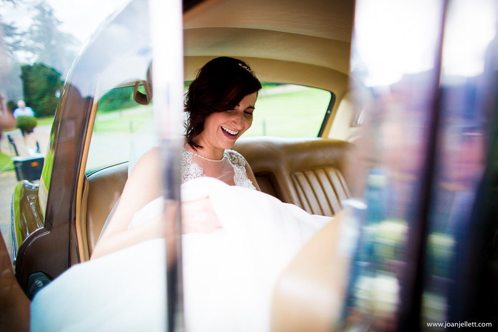 bride getting out of the car at Westmill Farm