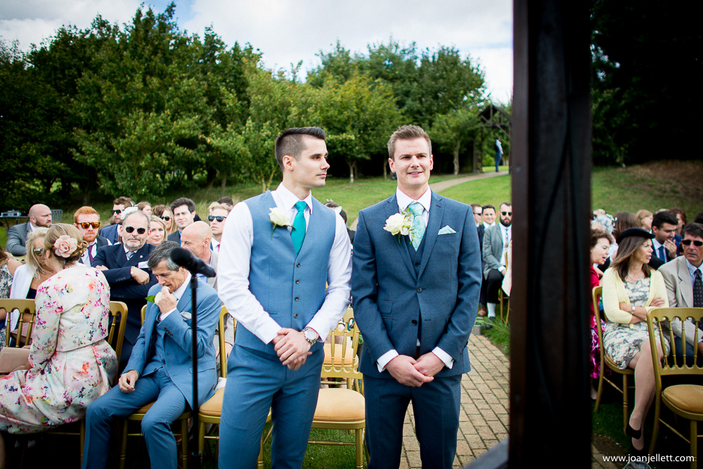 groom and his best man at the alter