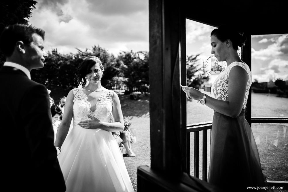 emotional bride listening to her sister's speech