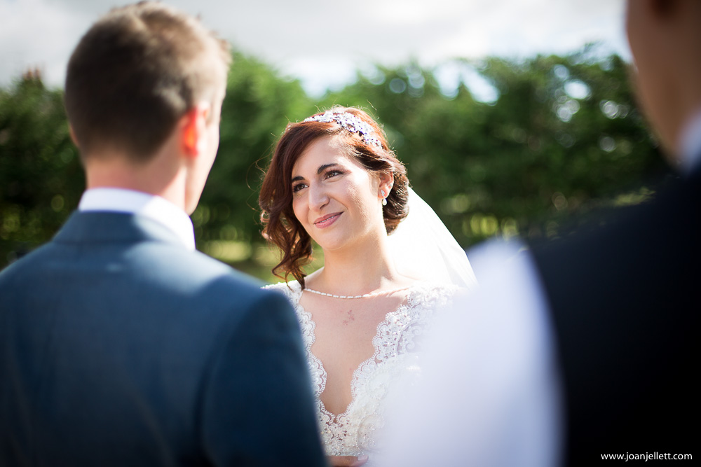 beautiful bride looking at her groom