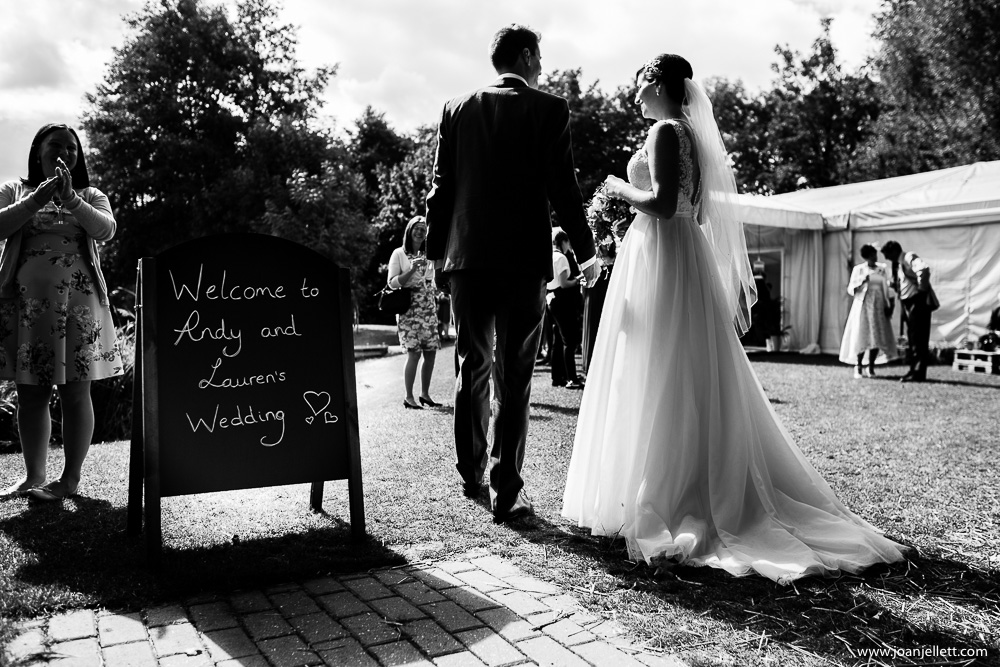 black and white back shot of bride and groom