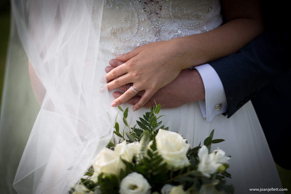 hand details of bride and groom