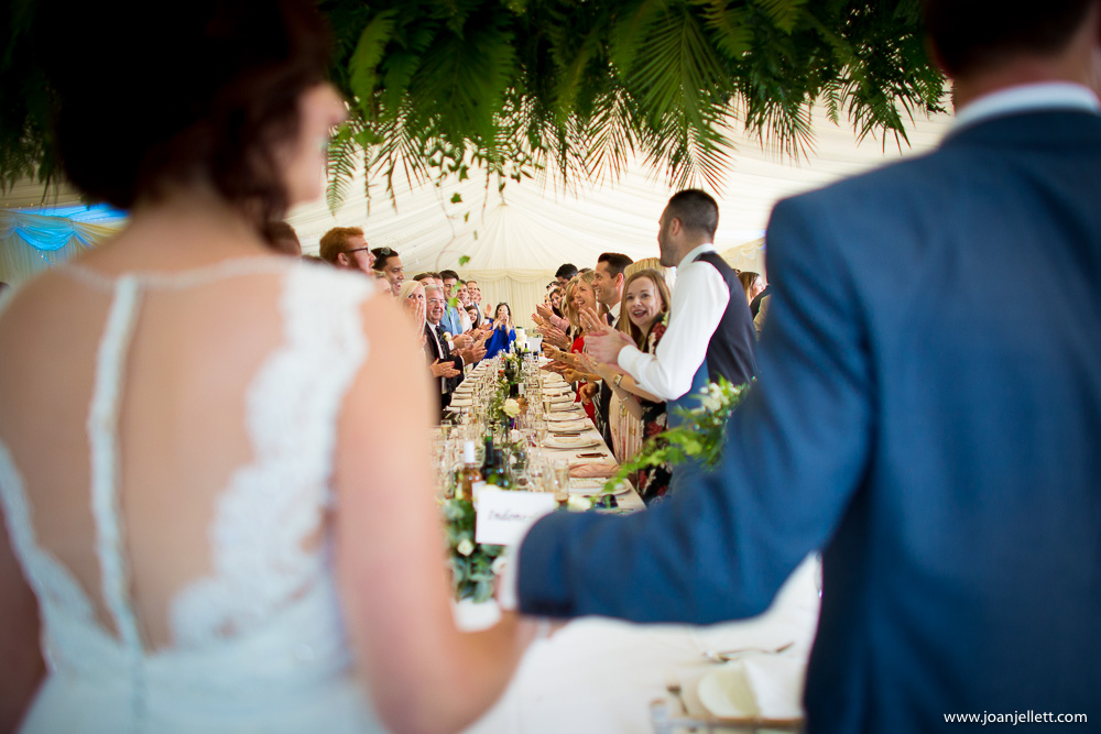 guests clapping at the happy couple