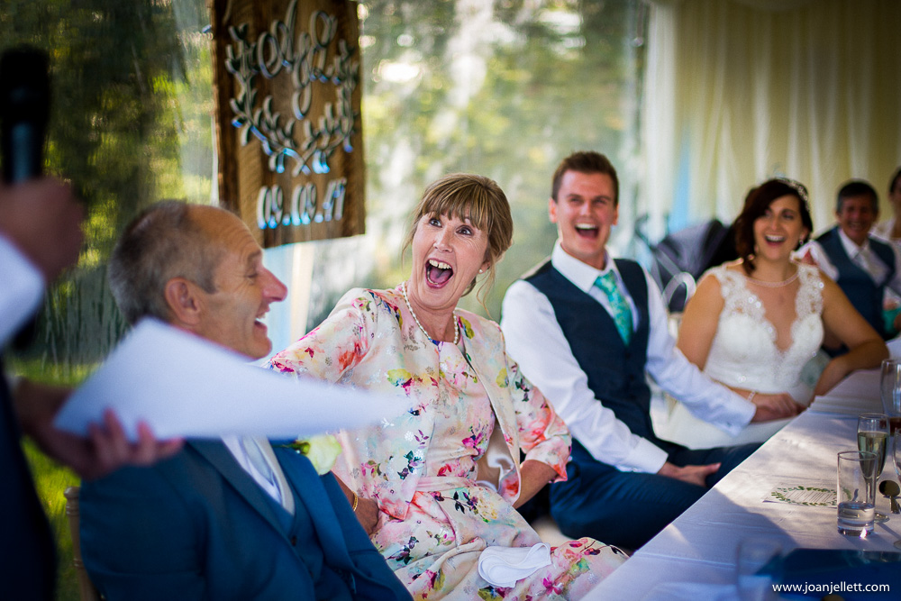 laughing mother of the groom during the speeches