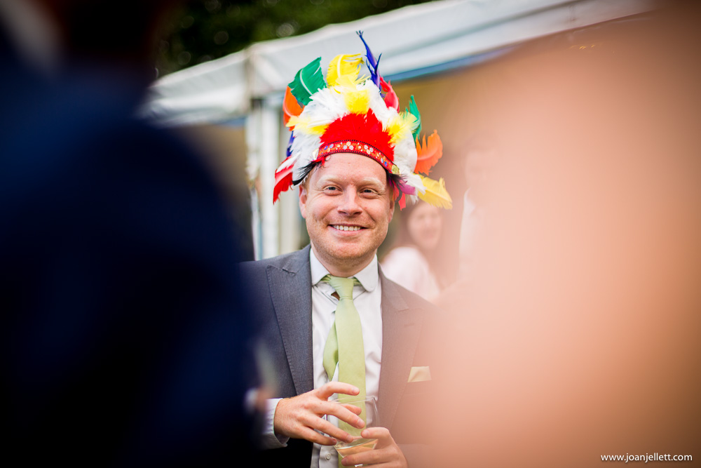 guest wearing a funny hat