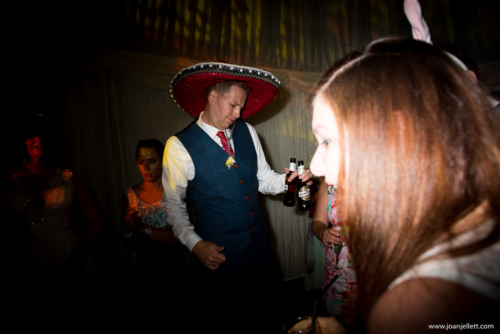 dancing guest with a hat on