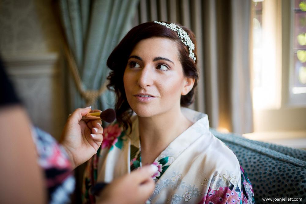 bride looking at her makeup artist