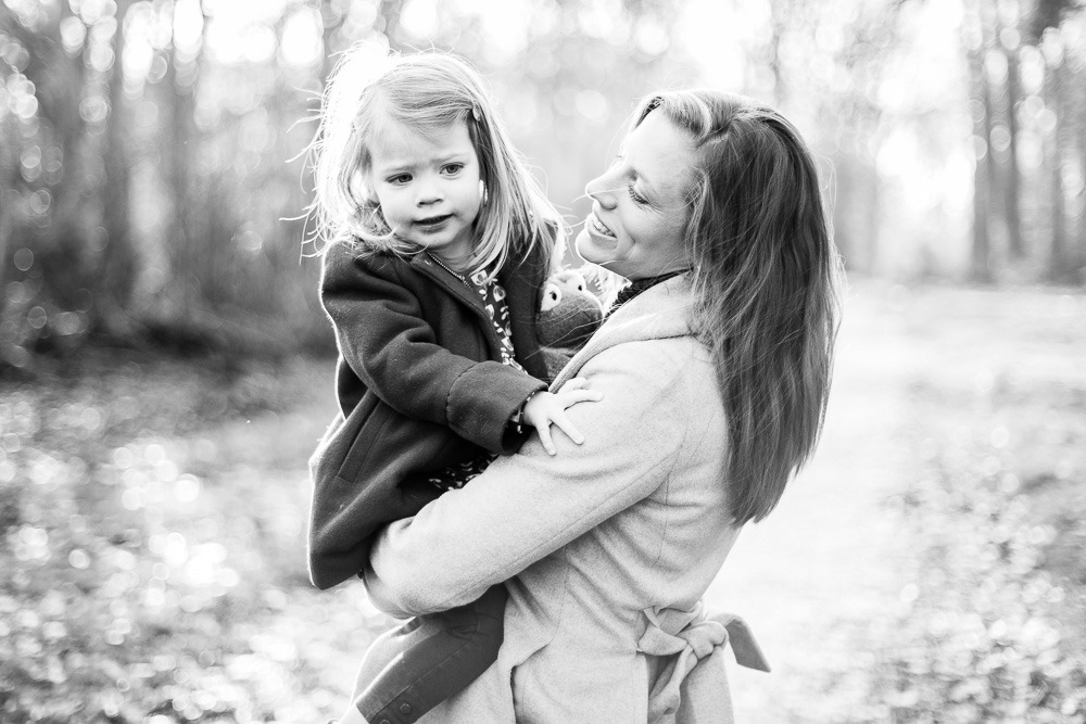 black and white shot of little girl an her mum