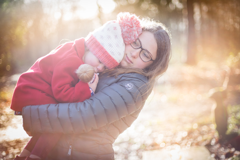 sisters hugging in the woods St Albans