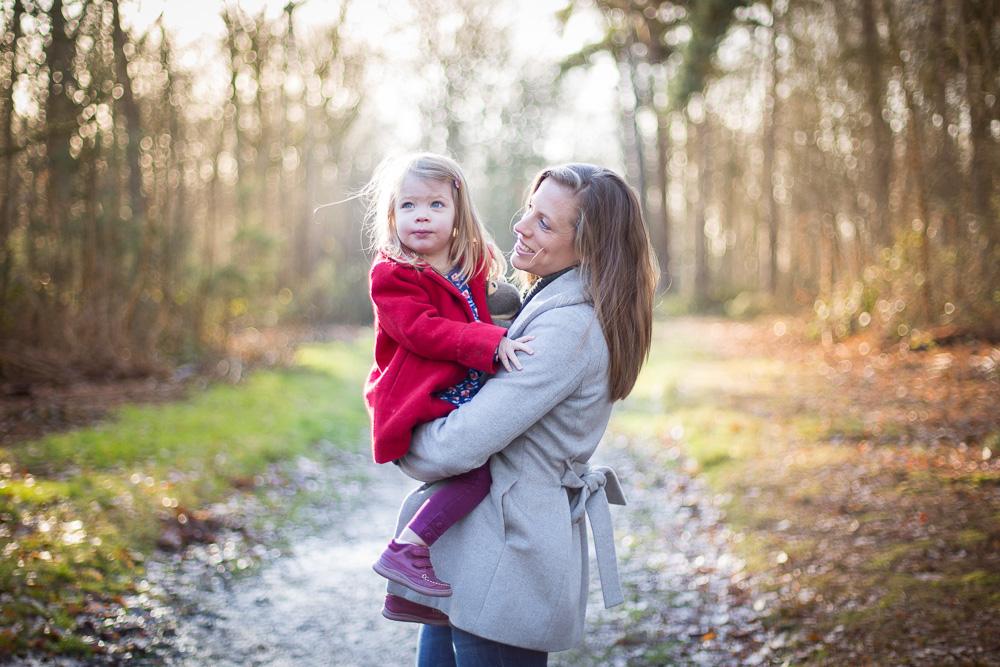 mum and daughter smiling hugging