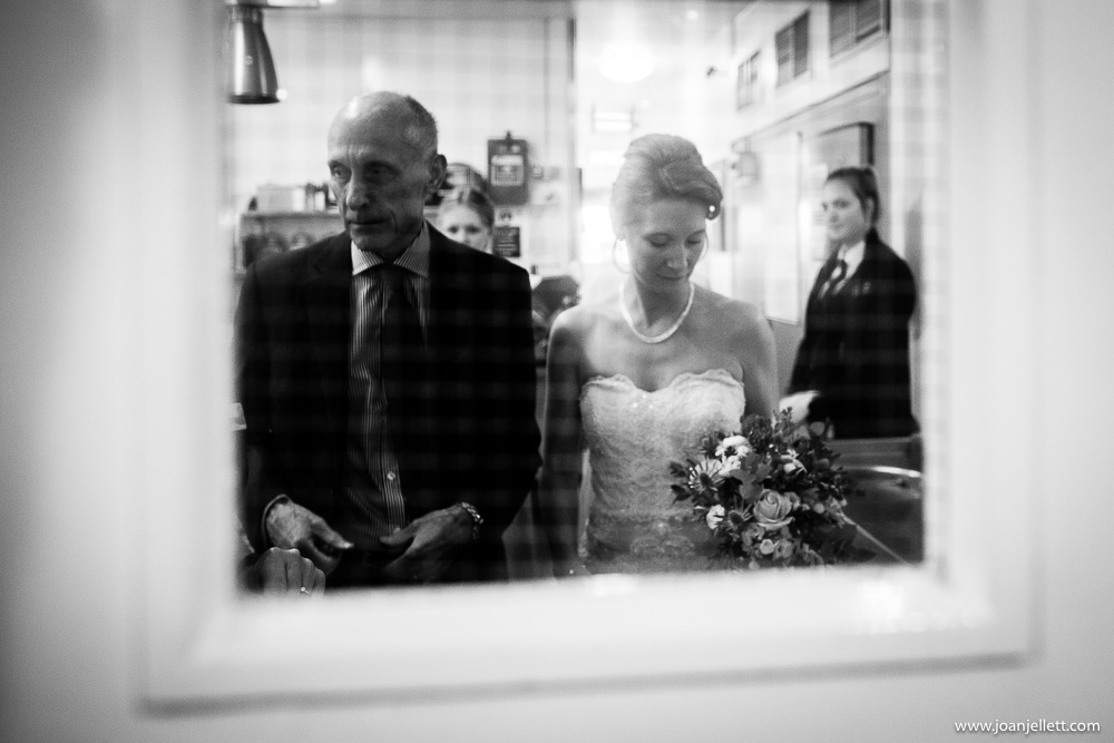 bride and her father waiting at the door