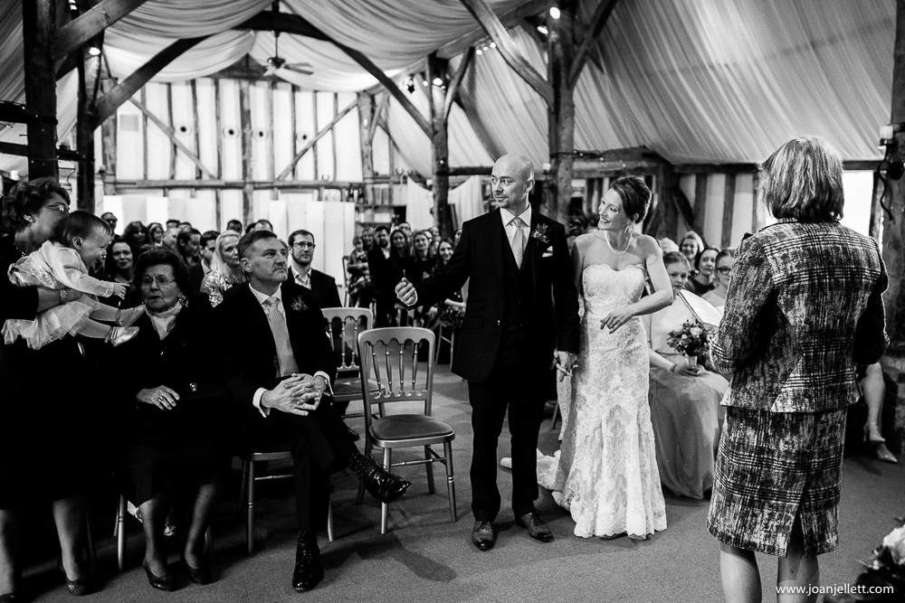 black and white shot of the bride and groom at the alter