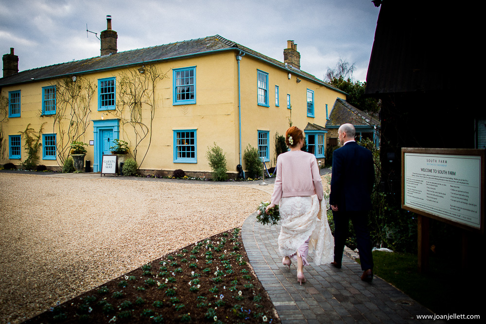 bride and groom walking down to the drawing room