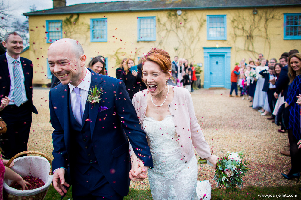 bride and groom laughing during the confetti shot