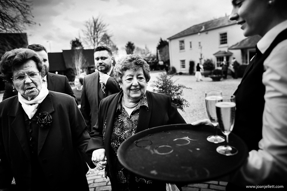 black and white shot of 2 guests drinking champagne