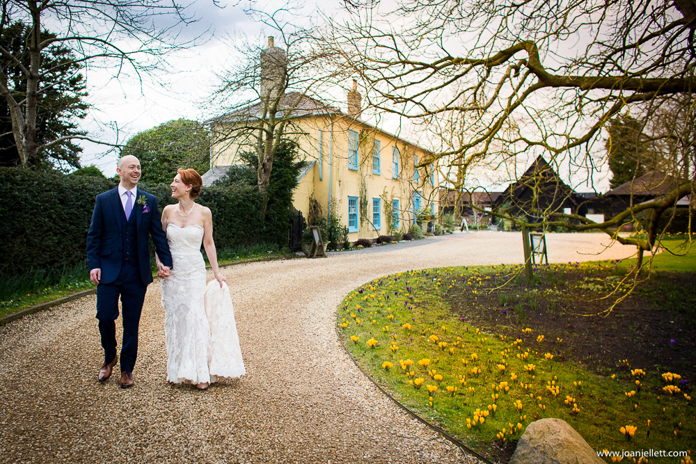 bride and groom walking in south farm