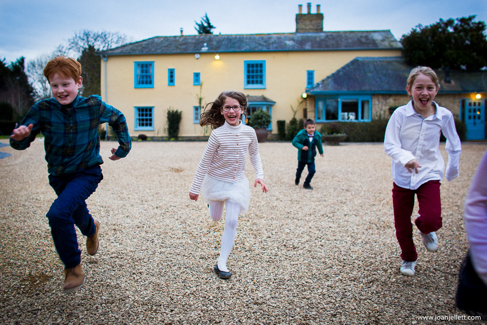kids smiling and running in front of South Farm Wedding Photography