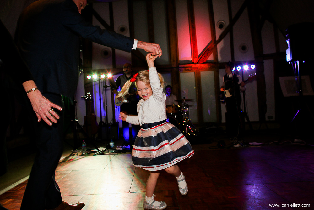 little girl dancing with her daddy