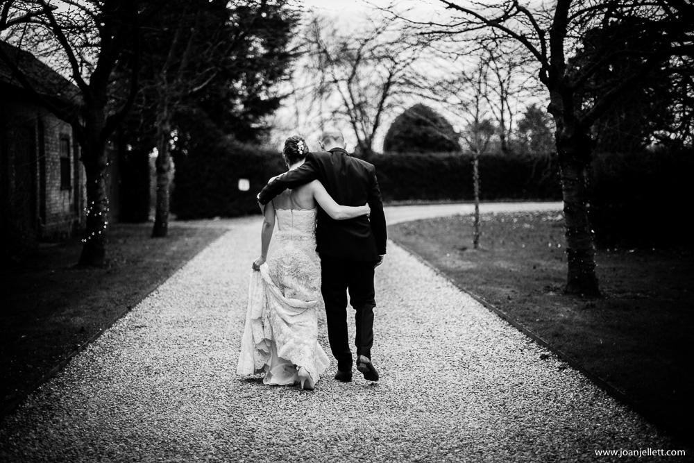 bride and groom walking back