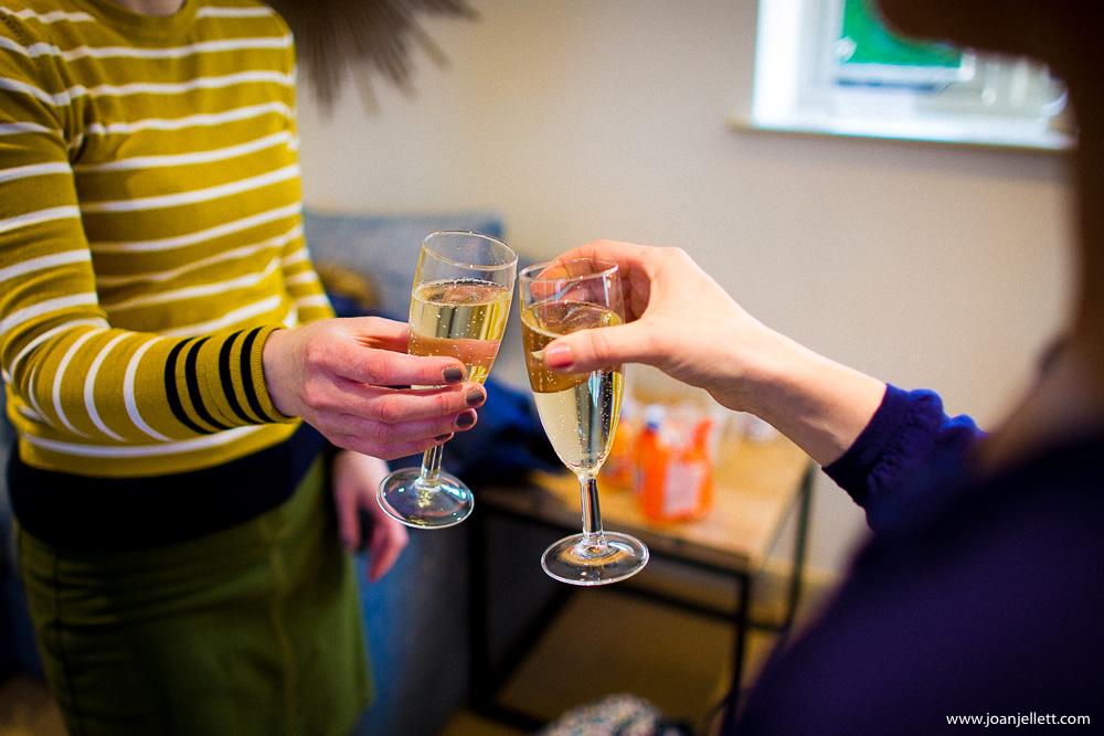girls clinging champagne flutes
