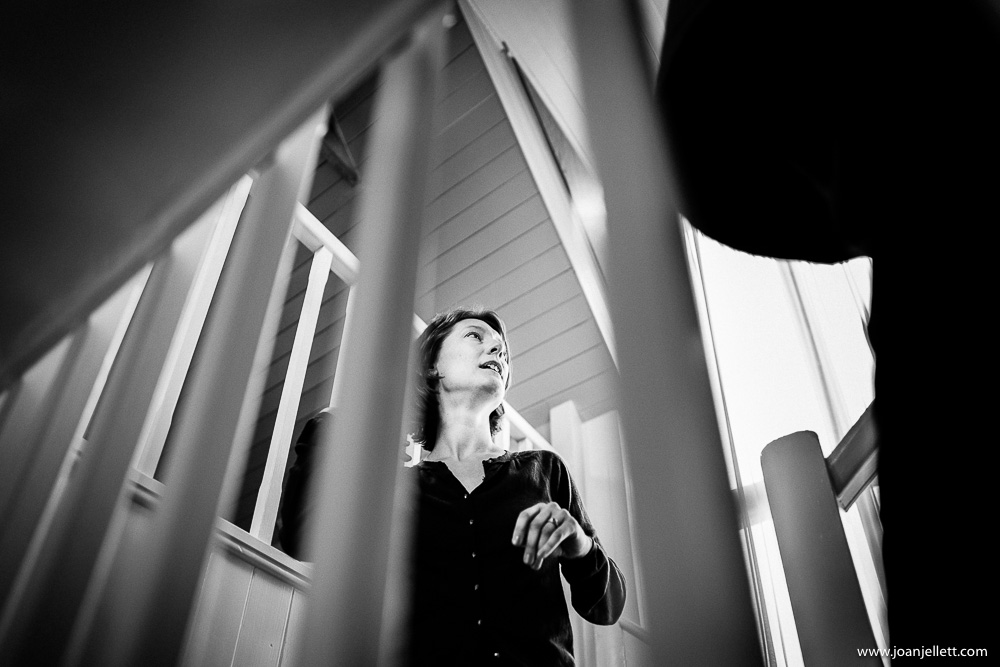 bride walking up the stairs in black and white
