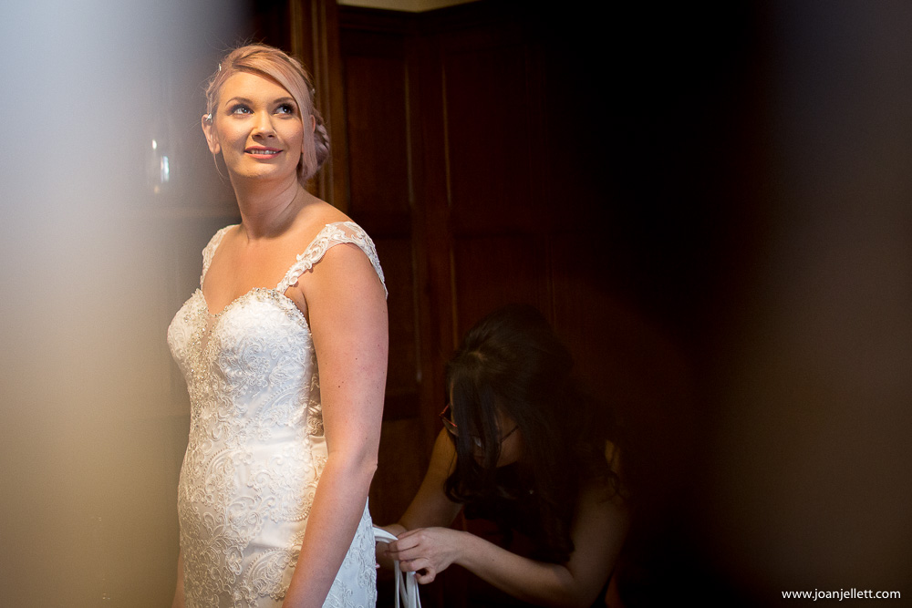 bride in her dress smiling
