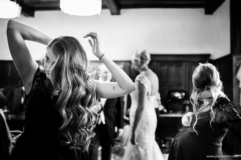 bridesmaid getting ready their hair done